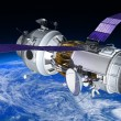 Space Station or spacecraft travels in orbit around the planet Earth. — Stock Photo #64757323