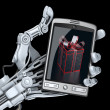 Robot holding smart phone with gift box on screen — Stock Photo #64756473