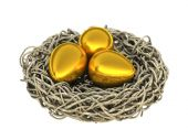 Three Easter golden eggs in a nest on white background. — Foto de Stock