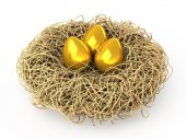 Three Easter golden eggs in a nest. — 图库照片