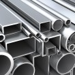 Metal round pipes and square tubes at warehouse — Stock Photo #66537601
