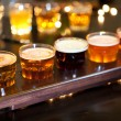 Set of glasses of light and dark beer on a pub background. — Stock Photo #66537675