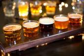 Set of glasses of light and dark beer on a pub background. — Stockfoto