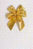 Gold gift bow isolated — Stock Photo