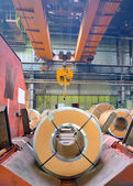 Steel coils in production shop of plant — Stock Photo
