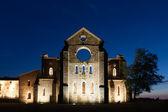 San Galgano roofless Cistercian abbey in Tuscany at sunset. — Stock Photo