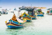 Traditional fishing boat (luzzu) in Marsaxlokk, a fishing villag — Stock Photo