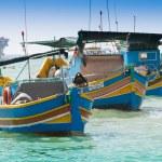 Traditional fishing boat (luzzu) in Marsaxlokk, a fishing village in Malta — Stock Photo #56664619