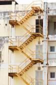 External yellow fire escape staircase — Stock Photo