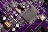 Modern purple circuit board — Stock Photo