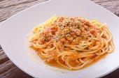 A portion of Italian spaghetti in white plate — Stock Photo