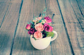 Vintage flower pot on wooden table background — Stock Photo
