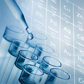 Science laboratory test tubes with periodic table background — Stock Photo