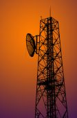 Silhouette communication tower — Stock Photo