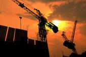 Silhouette of crane on Construction site — Stock Photo