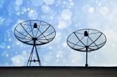 Satellite Dishes on rooftop with Chirstmas bokeh background — Stock Photo