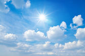 Sun and White clouds in blue sky background — Stock Photo
