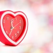 Red heart clock with bokeh background — Stock Photo #60140981