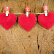 Lovely red hearts hanging on the clothesline on old wood backgro — Stock Photo #66038195