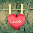 Lovely red hearts hanging on the clothesline on old wood backgro — Stock Photo #66038243