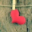 Lovely red hearts hanging on the clothesline on old wood backgro — Stock Photo #66038529