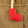 Lovely red hearts hanging on the clothesline on old wood backgro — Stock Photo #66038599