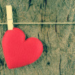Lovely red hearts hanging on the clothesline on old wood backgro — Stock Photo #66038693