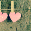 Lovely pink hearts hanging on the clothesline on old wood backgr — 图库照片 #66038857