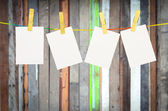 Empty white photographs hanging on a clothesline isolated on whi — Stock Photo