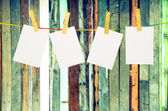 Empty white photographs hanging on a clothesline isolated on whi — Stockfoto