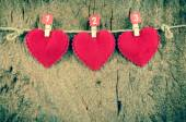 Lovely red hearts hanging on the clothesline on old wood backgro — 图库照片