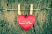 Lovely red hearts hanging on the clothesline on old wood backgro — Foto Stock
