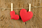 Lovely red hearts hanging on the clothesline on old wood backgro — Stock Photo