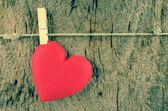 Lovely red hearts hanging on the clothesline on old wood backgro — Fotografia Stock