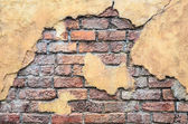 Cracked stone wall background — Stock Photo