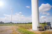 Wind turbine against cloudy blue sky background — Stock Photo