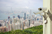 Surveillance Security Camera or CCTV over city — Stock Photo