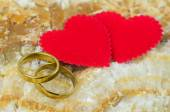 Couple of gold rings on marble stone background — Stock Photo
