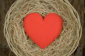 Single red heart shape in basket — Stock Photo