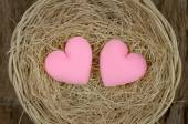 Couple of pink heart shape in basket — Stock Photo
