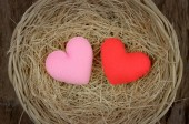 Pink and red heart shape in basket — Stock Photo