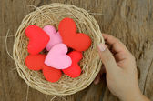 Hand pick up a group of heart shape — Stockfoto