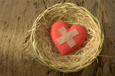 Wounded heart in basket — Stock Photo