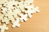 Jigsaw puzzle pieces on wood background — Stock Photo