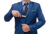 Business man hand holding knife isolated on white background — Stock Photo