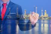 Business man and Oil refinery at twilight background — Stock Photo
