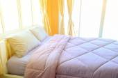 Detail of the bed in bedroom — Stock Photo
