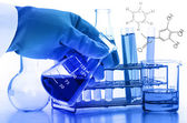 Scientist hand holding laboratory test tubes — Stock Photo