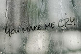 Natural water drops on glass window with the text you make me cry — Stock Photo