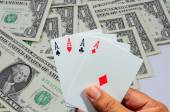 Hand and four aces , playing cards — Stock Photo